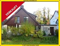 VERKAUFT! Gemütliches Einfamilienhaus mit Kamin, Garage u. Sonnengarten in idyllischer Lage